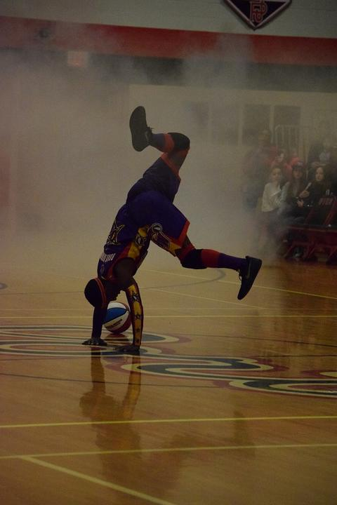 Wizards player doing handstands over basketball