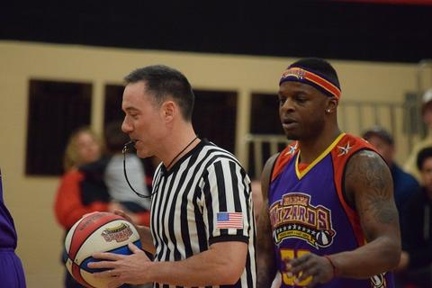 Wizards player standing behind referee