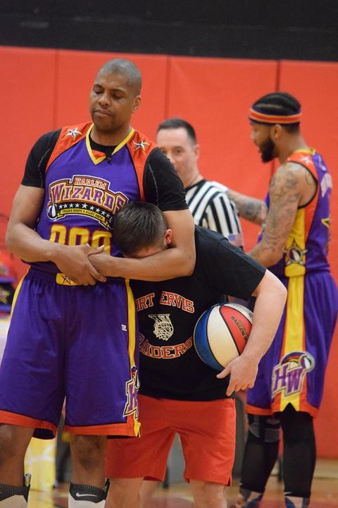 Wizards player putting Port Jervis player in headlock
