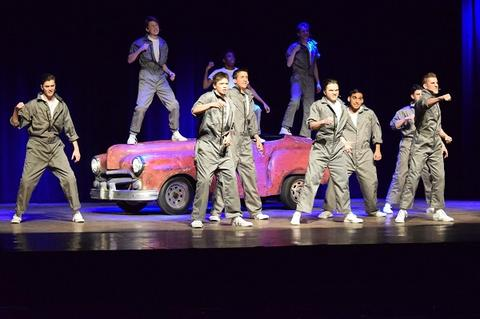 "Musical number in ""Grease,"" in front of prop car"