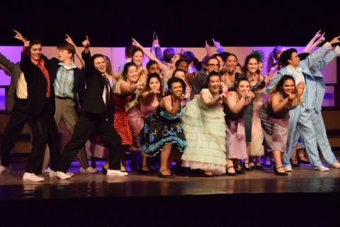 "All-cast musical number during ""Grease"""