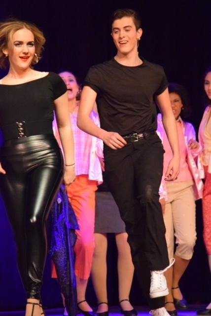 "Danny and Sandy in black outfits during ""Grease"""