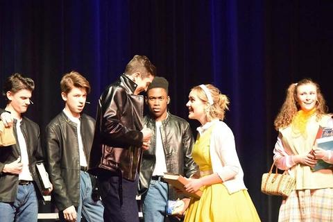 "Sandy talking to Danny during ""Grease"""