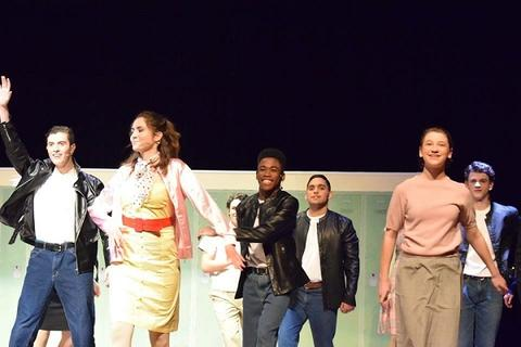 "Another group production number in ""Grease"""