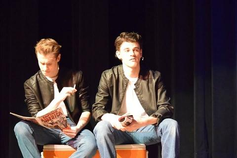 Danny and T-Bird onstage; T-Bird reading comic book