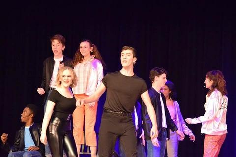 "Another group shot during final number in ""Grease"""