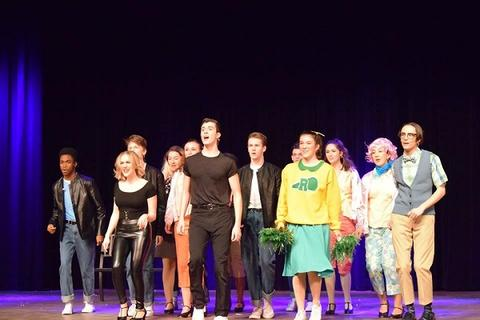 "Final cast singalong during ""Grease"""
