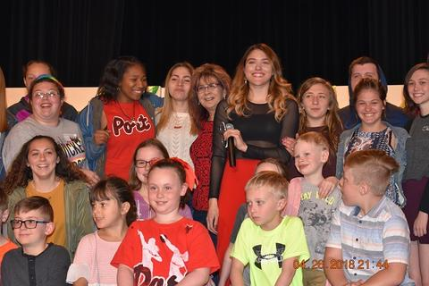 Kendyle Page in group photo with young Port Jervis students