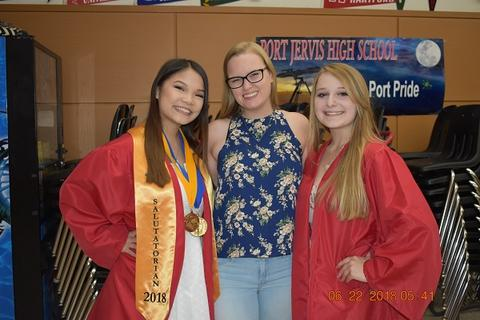 Two grads pose with female friend