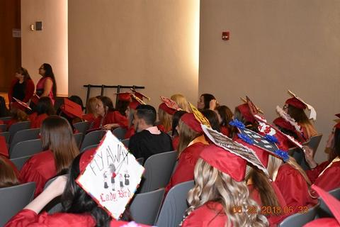 More from-behind graduate photos in auditorium