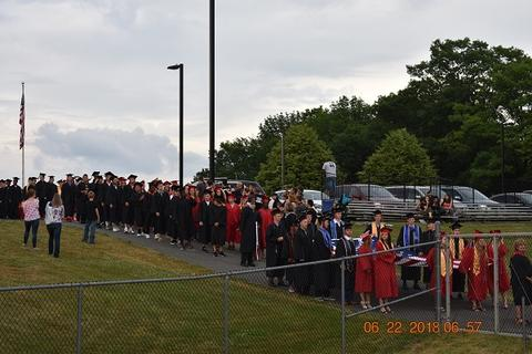 Outdoor processional with grads