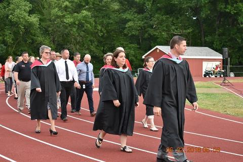 Larger group of staff walking on track