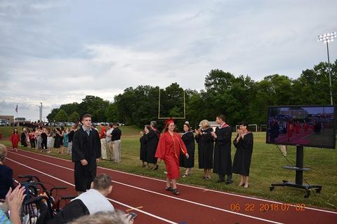 More grads walking the processional along the track