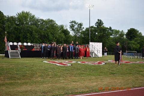 Grads standing at midfield