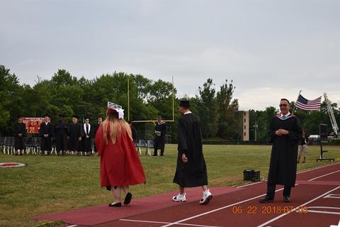 More grads walk toward midfield