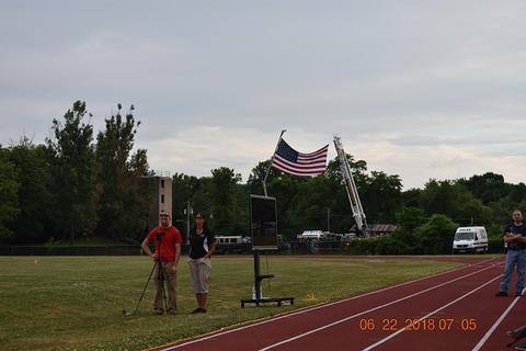 Long distance view of flag aloft on crane