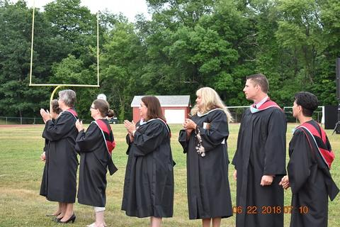 Closeup of baccalaureate staff clapping