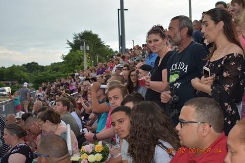 Crowd in bleachers watching graduation