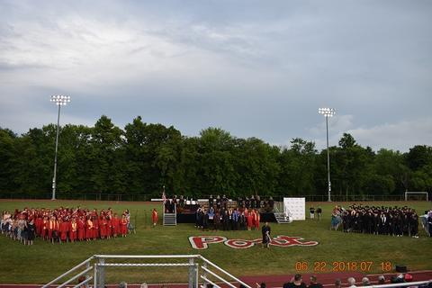 Long-distance shot of ceremony, taken from bleachers