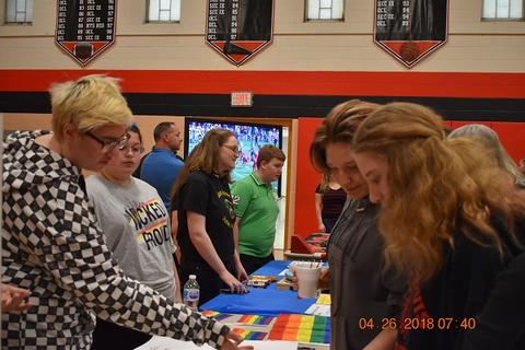 Students looking at the LGBTQ table