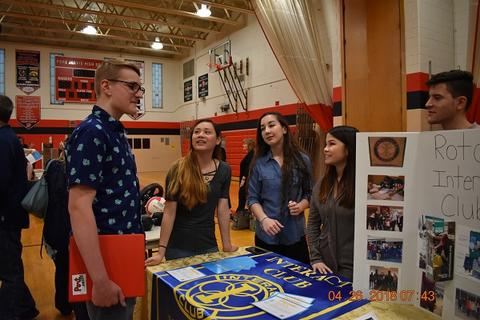 Students talking around the Rotary International booth
