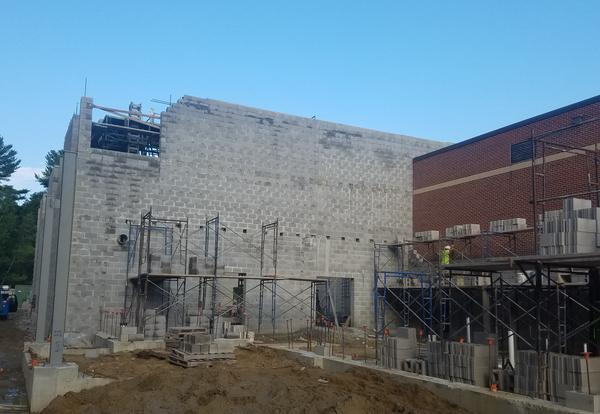 Concrete main wall of new gymnasium under construction