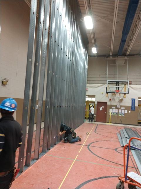 Wall construction for new gym hallway at Newmarket Elementary School