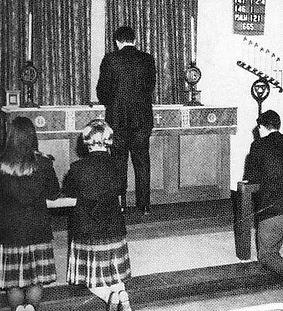 Black and white photo shows a church ceremony at Martin Luther School.