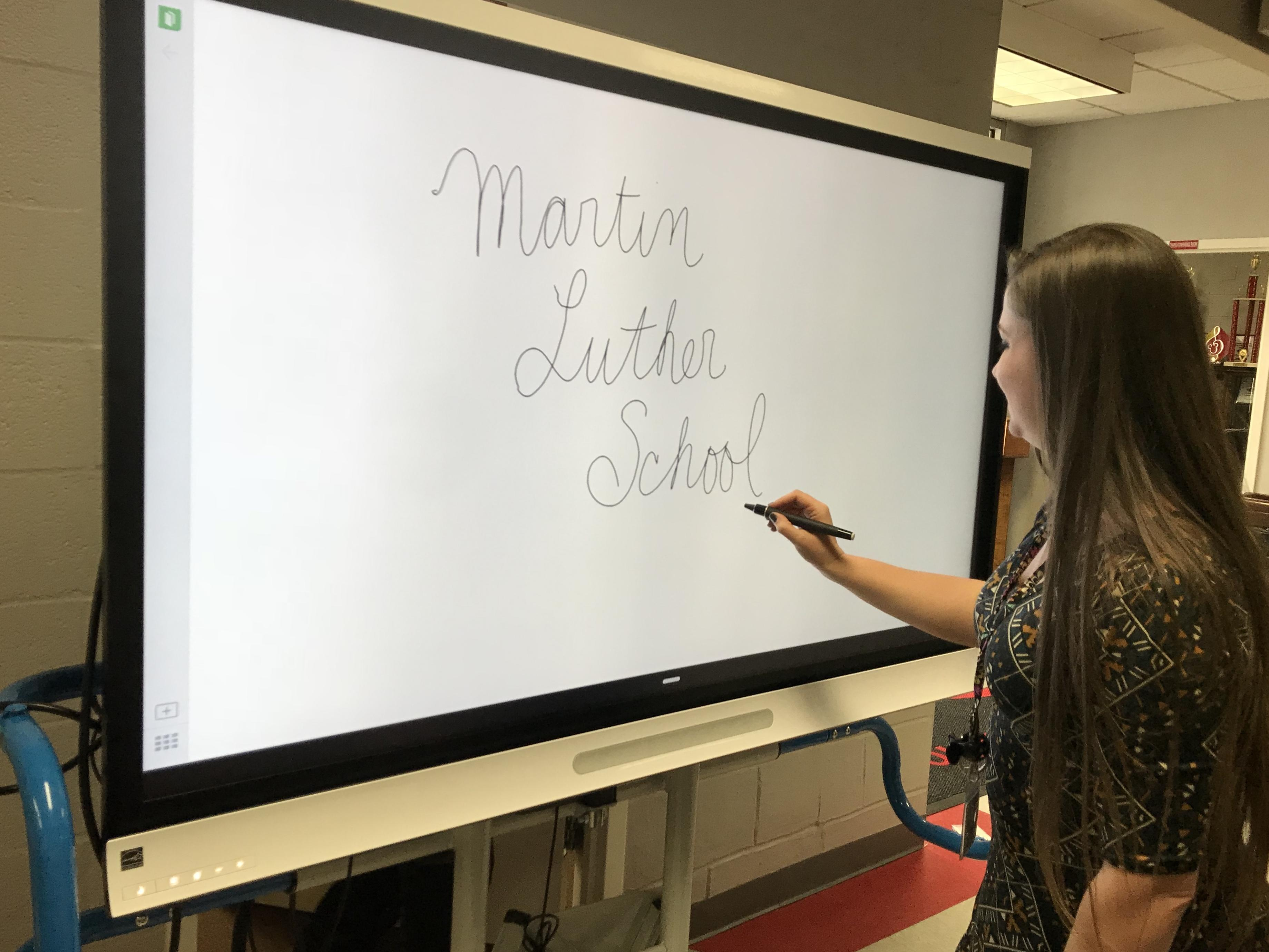 New technology at Martin Luther School, such as whiteboards.