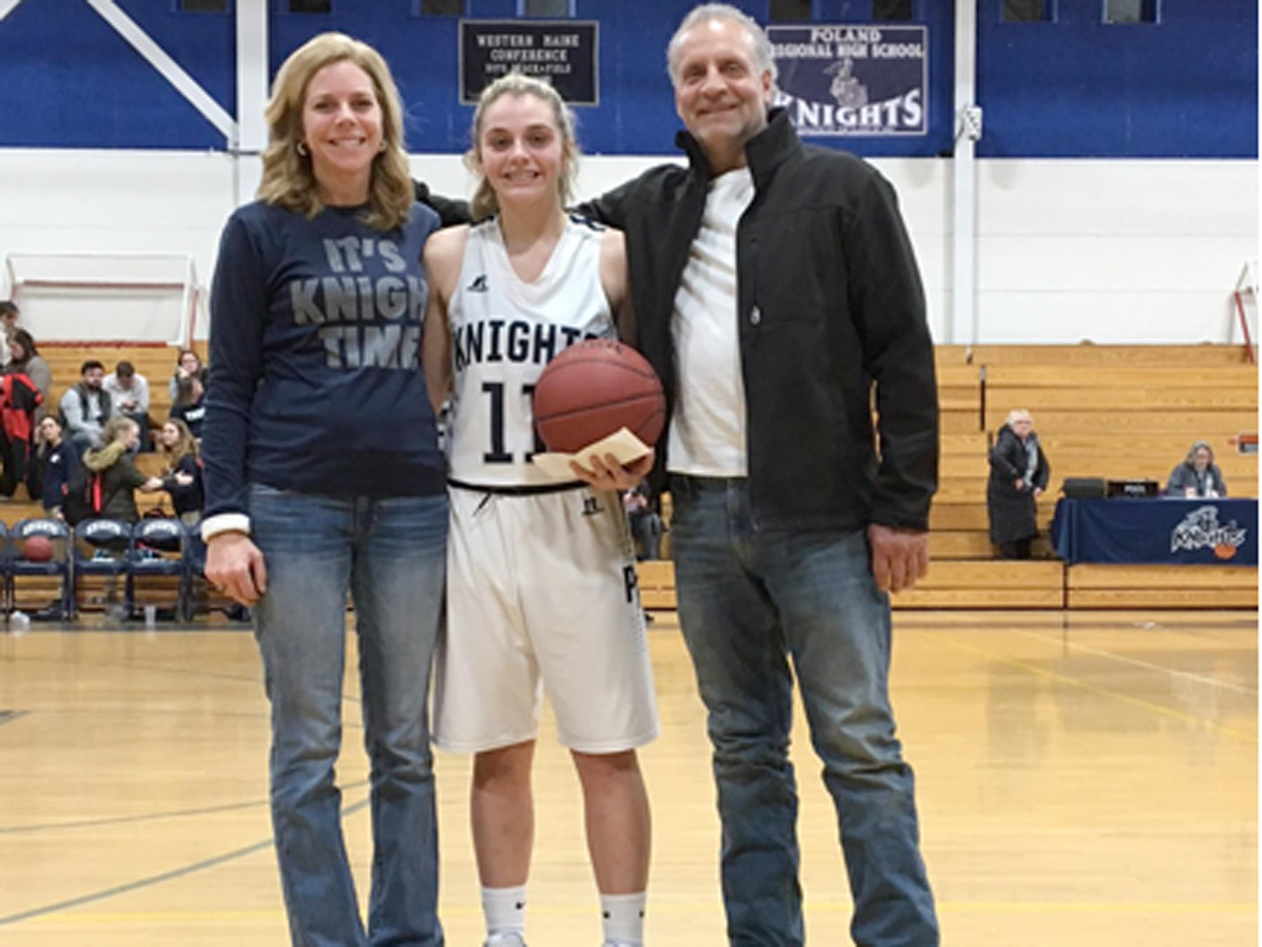 PRHS Basketball Player with her parents