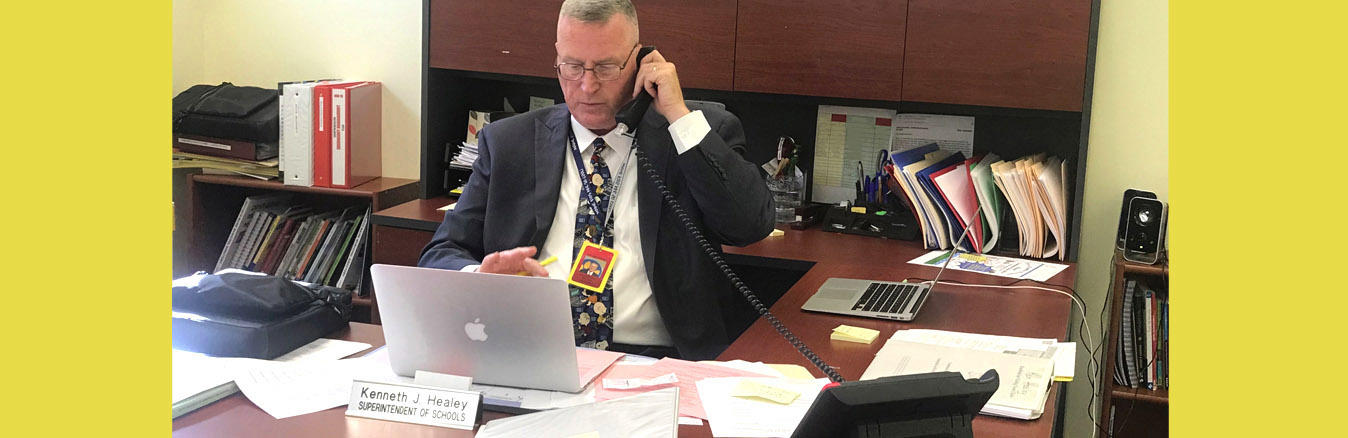 Photo of Superintendent Healey on the phone at his desk.