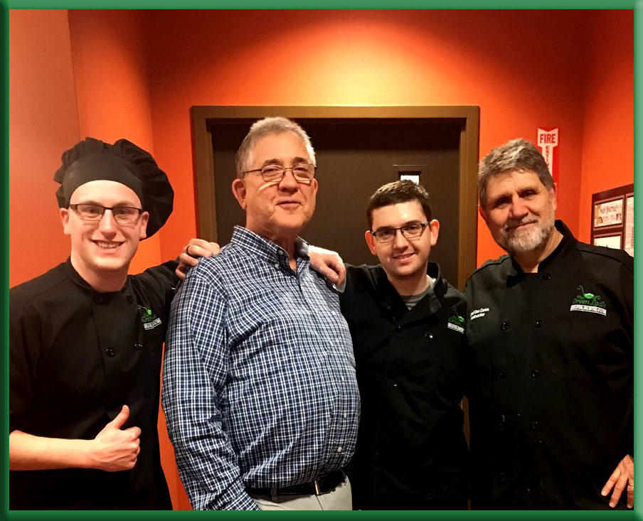 Photo of school board member Norm Beauparlant with students Corbin Chamberlain and Jarrett Golding-Timberlake, and Chef Dan Caron.