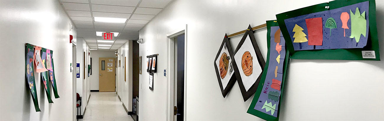 Photo of student's artwork displayed on the walls at the Central Office of RSU 16