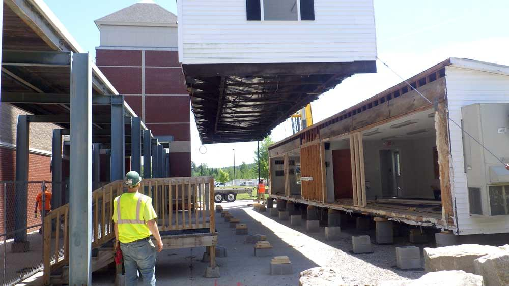 Photo of module classroom being moved.