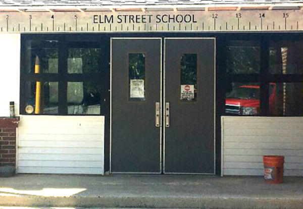 Partial photo of ruler and pencil decor at the front of Elm Street School