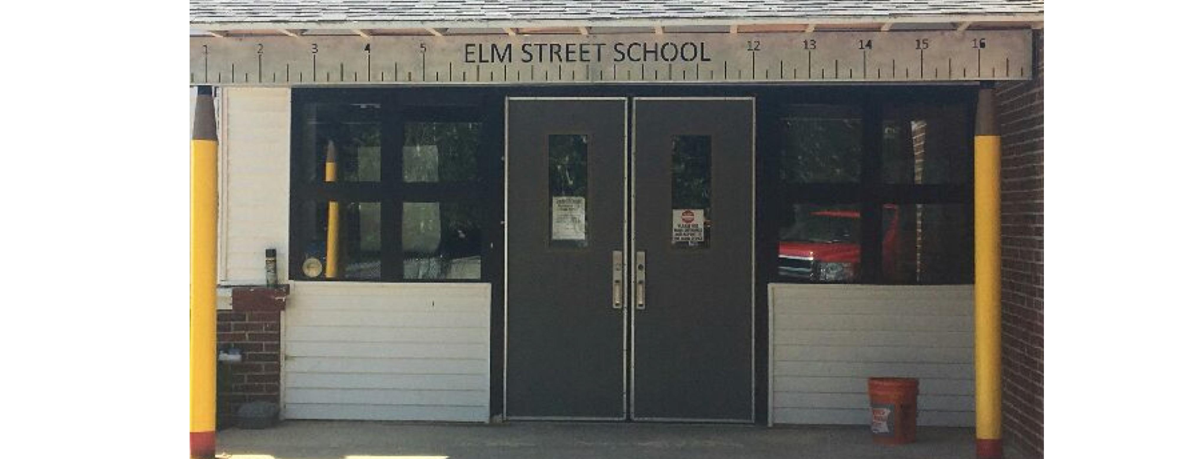 Photo of the pencils and ruler used in decor at the front of Elm Street School. Very cool!