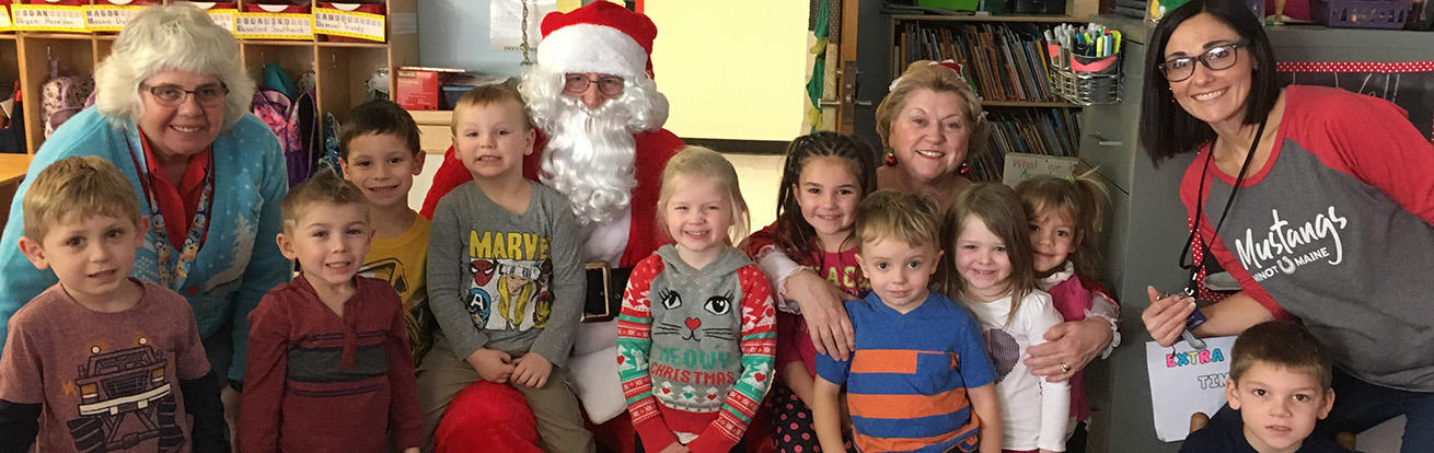 Photo of Santa and Mrs. Claus's visit to MCS with the 4YO students!