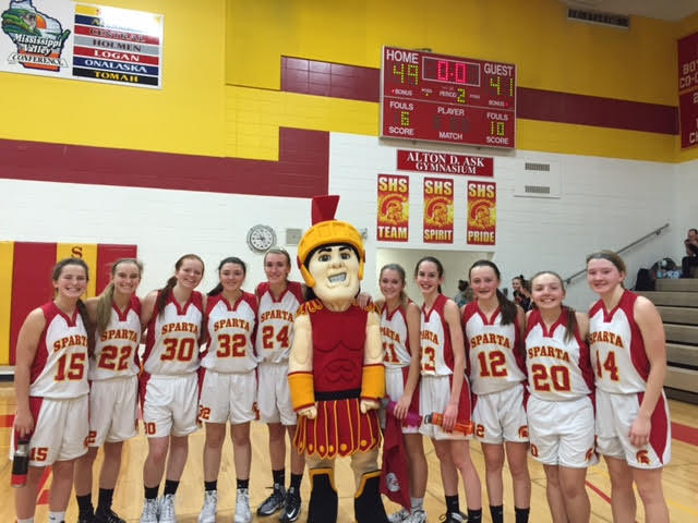 Spartan Man poses with the Sparta High School Girls Basketball team