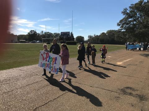 """Students walking with book banner, """"Pippi Longstocking"""""""