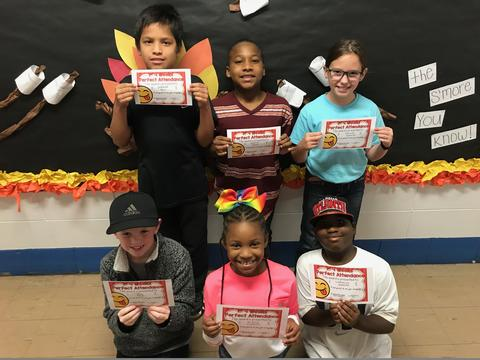 Six students pose with certificates