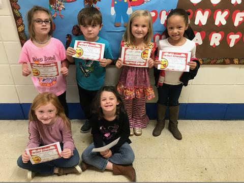 Group of six students pose with certificates
