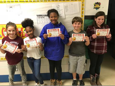 Five students stand in row, holding certificates
