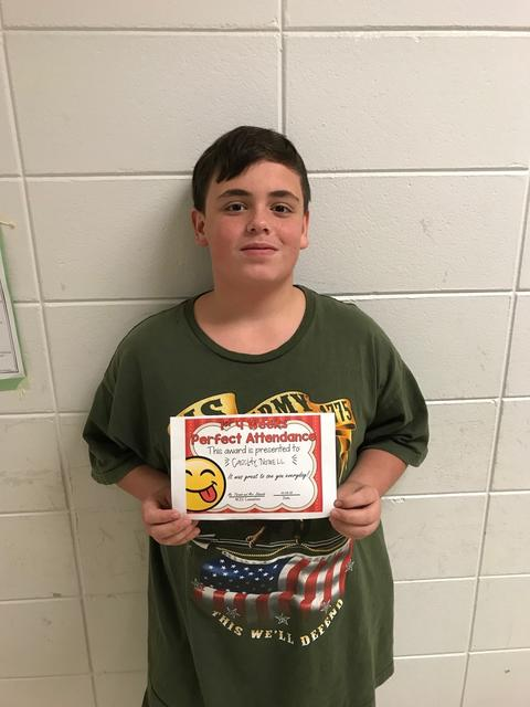 Male in green t-shirt poses with certificate