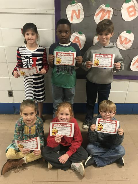 Six students are smiling while holding certificates