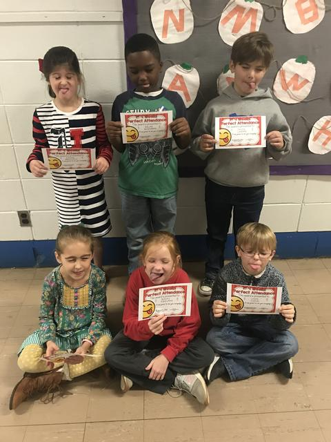 Six students being goofy and holding certificates