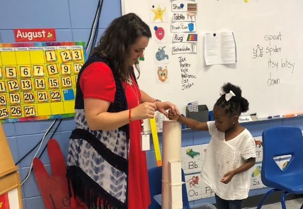 Image of Teacher with Student playing with Itsy Bitsy Spider Water Spout