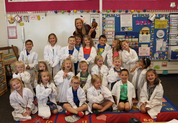 students dressed as scientists