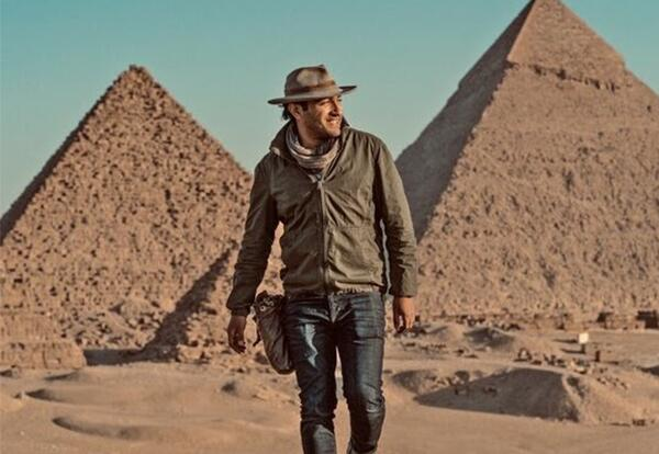 PIcture of Ramy Romany in front of Pyramids