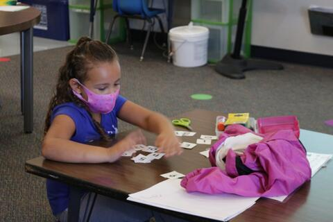 Girl working on number flash cards
