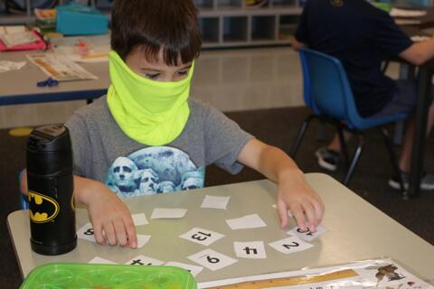 Boy working on number flash cards